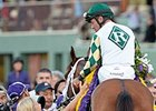"Kathy Ritvo congratulations Gary Stevens after Mucho Macho Man's win in the Classic.<br><a target=""blank"" href=""http://photos.bloodhorse.com/BreedersCup/2013-Breeders-Cup/Classic/33150031_7ZnLk4#!i=2880911124&k=bVwvNFs"">Order This Photo</a>"