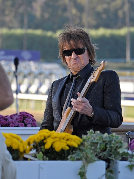 "Caption: Guitarist Richie Sambora with Bon Jovi plays the ""Call to the Post""