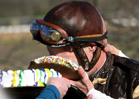 Jockey Calvin Borel gets win 5,000th on Hezunusal at then receives cake to the face.