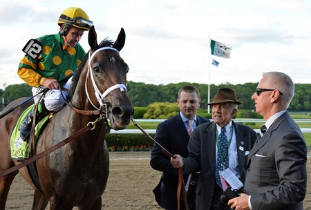 Jockey Mike Smith sits atop Palace Malice after winning  the 2013 Belmont Stakes. They are met by trainer Todd Pletcher as Cot Campbell leads them to the winner's circle.