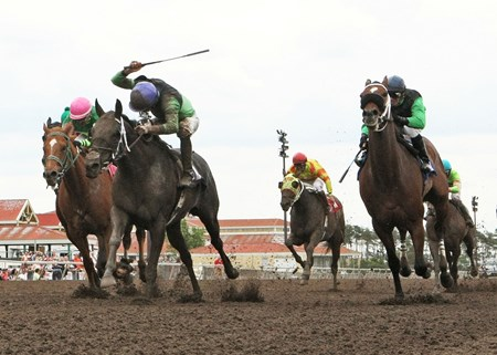 Signsealndeliver and jockey Ry Eikleberry wins the Dark Star Cup at Canterbury Park in Shakopee, Minnesota