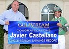 Javier Castellano (with Racing Secretary PJ Campo) celebrates the Earnings Record.