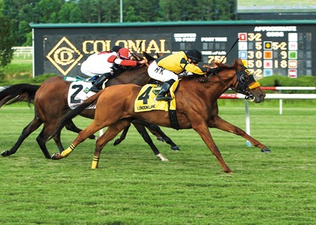 London Lane and jockey Horacio Karamanos wins The 9th Running of the Colonial Turf Cup at Colonial Downs in New Kent, Virginia.