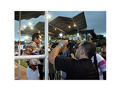 The press talks with jockey Moises Gonzalez following the Clasico del Caribe.