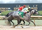 Race Day fights off Midnight Hawk to win the Razorback Handicap.