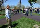 Bruce Howard observes horses at Keeneland