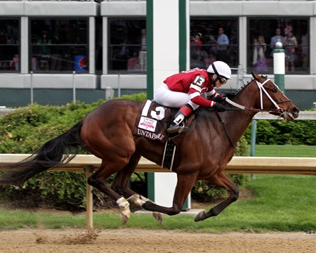 Untapable and jockey Rosie Napravnik in the 140th Running of the Kentucky Oaks at Churchill Downs on May 2, 2014.