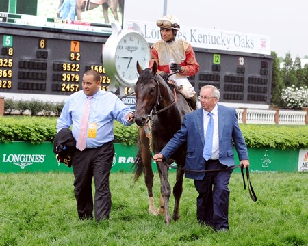 Orb and Shug McGaughey walk towards the Churchill Downs winner's circle.