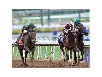 "Untapable pulls away for the win in the Breeders' Cup Distaff.<br><a target=""blank"" href=""http://photos.bloodhorse.com/BreedersCup/2014-Breeders-Cup/Distaff/i-TKXbS8F/A"">Order This Photo</a>"