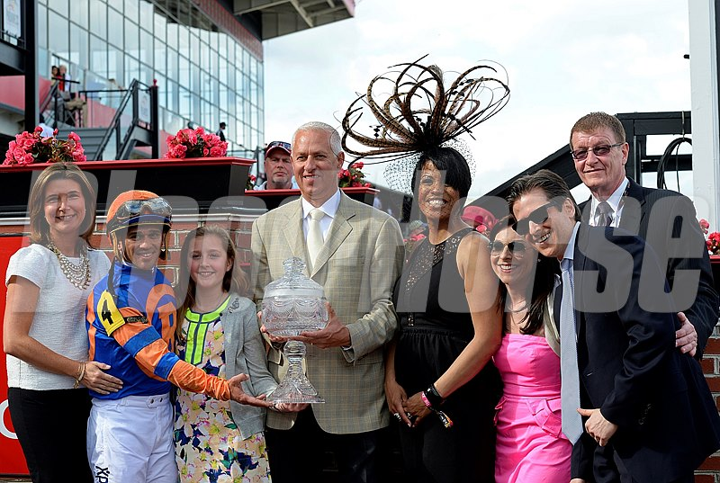 Caption: l-r, Mrs. Todd Pletcher, Javier Castellano, Pletcher's daughter, Todd Pletcher, Baltimore mayor Stephanie Rawlings Blake, ?, ?, Tom Chukhas Jr., Pimlico president.