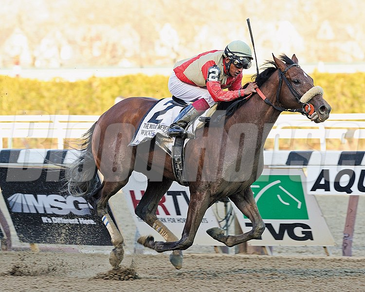 Wicked Strong and jockey Rajiv Maragh wins the Grade I Wood Memorial Stakes at Aqueduct on April 5, 2014.