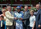 Ralph Evans, on the right holding trophy, following Upstart's win in the Funny Cide Stakes.