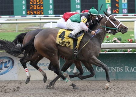 Lexi's Love with Diego Saenz aboard gets a head in front of All Woman and jockey Rosie Napravnik to win the 23rd running of the $100,00 Louisiana Champions day Lassie at Fair Grounds Race Course & Slots.