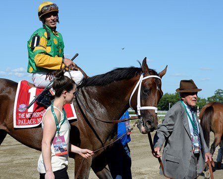 Caption:Owner Cot Campbell walks in his horse. Palace Malice with John Velazquez wins the Metropolitan