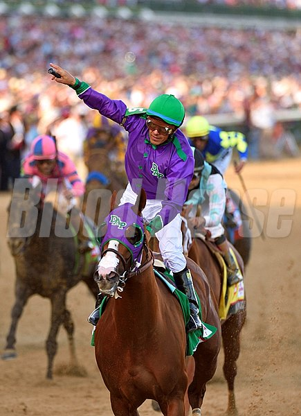 Victor Espinoza celebrating aboard California Chrome after winning the 140th Kentucky Derby.