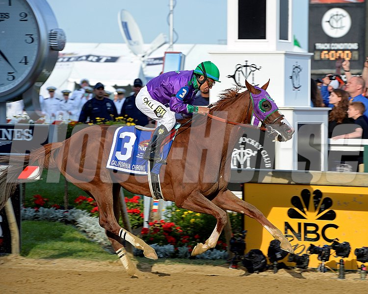 California Chrome crosses the finish line to win the 139th Preakness Stakes (gr. I).