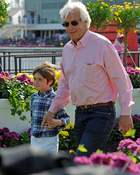 Caption: trainer Bob Baffert with son Bodie enters the winners Circle.