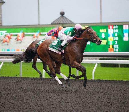 Caption:  Emollient with Mike Smith up wins the Juddmonte Spinster Stakes (gr. I). Summer Applause was second