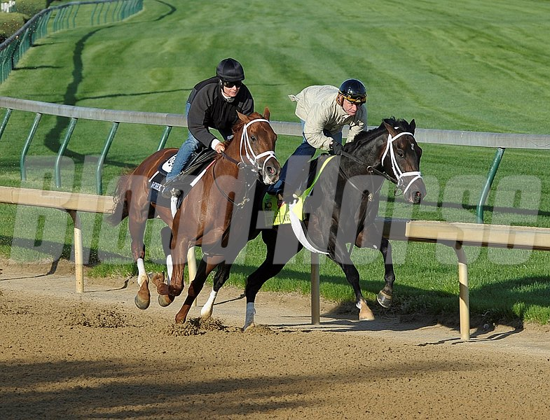 Revolutionary on the inside with Calvin Borel works at Churchill Downs on Sunday morning April 21 in preperation for the 2013 Kentucky Derby.