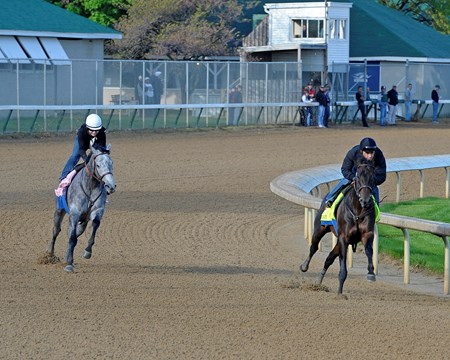 Caption:  Code West with Mike Smith works, Baffert filly Midnight Lucky on left, working together.