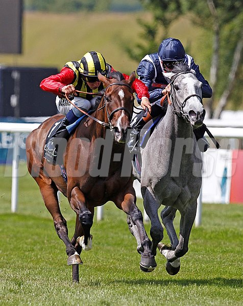 Elusive Kate ridden by William Buick (left) wins from Sky Lantern (right) in the Falmouth Stakes at Newmarket in Suffolk, England.