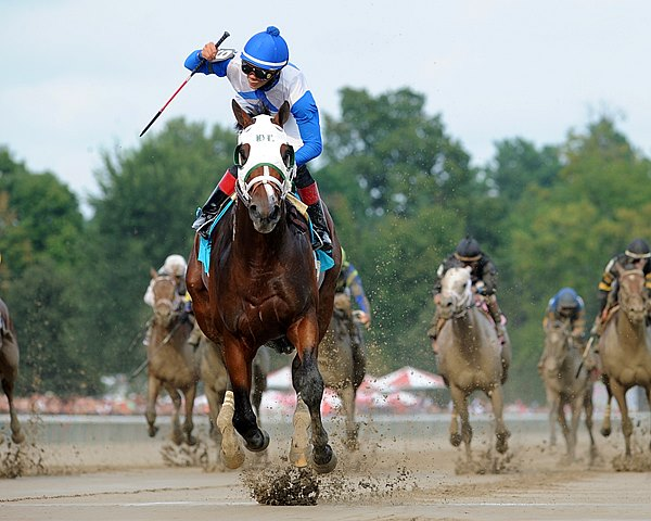 Strong Mandate turned in a dominant performance in the $300,000 Grade I Hopeful Stakes at Saratoga Race Course in New York, winning by 9 3/4 lengths.