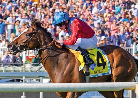 Dank and jockey Ryan L. Moore capture the Grade I Beverly D. Stakes at Arlington Park.