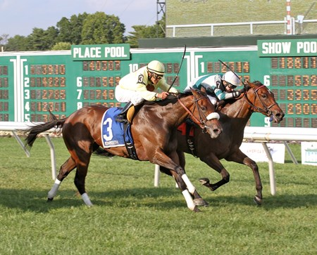 Racing in last to the far turn, maiden winner Munirah rallied to run down pacesetter Sumba Sunset to win the $105,000 Grade III Boiling Springs Stakes in the final stride at Monmouth Park.