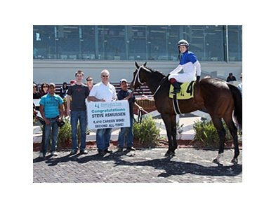 Jake Jourdan in the Winner's Circle, Steve Asmussen's 6,418th win.