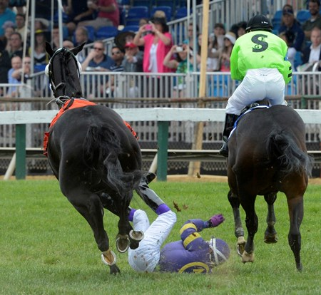 Jockey Emilio Flores looses an iron on his mount Yougotthatgoinforu and is unseated during the 4th running of the James E. Murphy Stakes at Pimlico Race Course in Baltimore, Maryland.