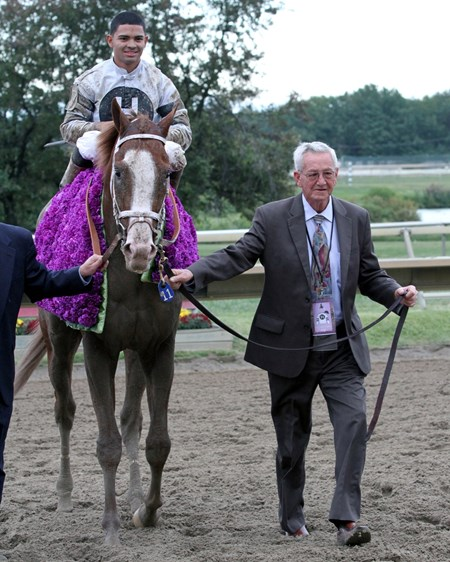 Will Take Charge w/Luis Saez is led towards the winner's circle by owner Willis D. Horton following their win in the 34th Running of the Pennsylvania Derby at Parx on September 21, 2013.
