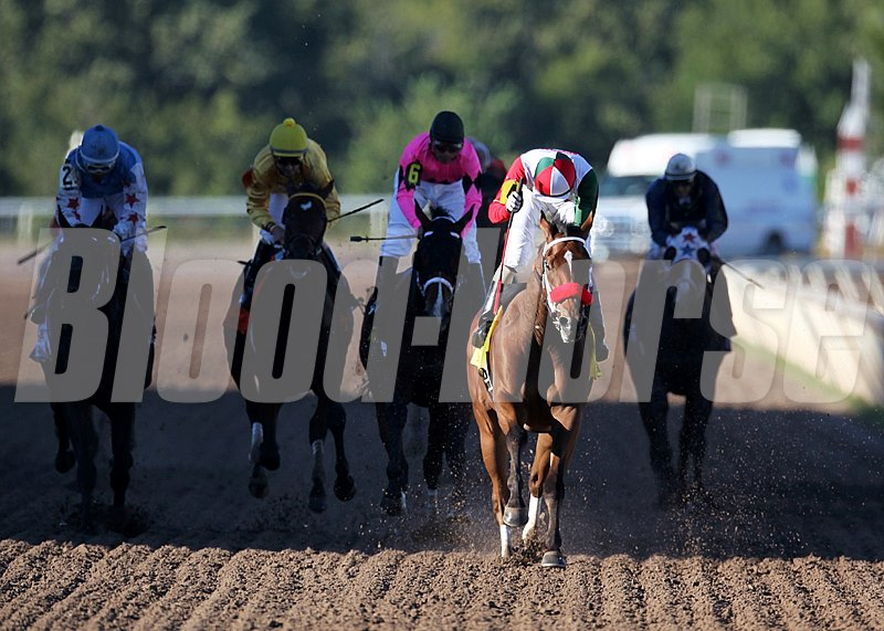 Jockey Rico Walcott gives a fist pump as he wins the Oklahoma Derby with Broadway Empire. 9/29/2013