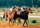 Alysheba makes his move in the 1987 Super Derby. Alysheba was the first Super Derby winner to later win the Breeders' Cup Classic.