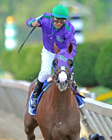 Victor Espinoza celebrates California Chrome's victory.