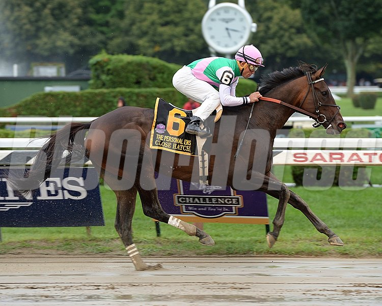 Close Hatches and jockey Joel Rosario wins the Grade I Personal Ensign Stakes at Saratoga Race Course on August 22, 2014.