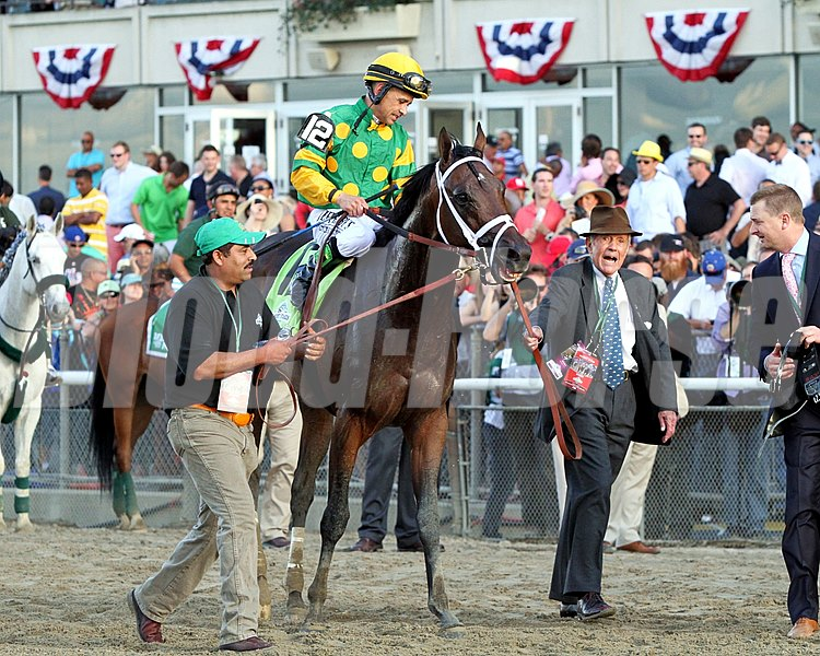 A delighted Cot Campbell leads Palace Malice toward the winner's circle after winning the 145th running of the Belmont Stakes.