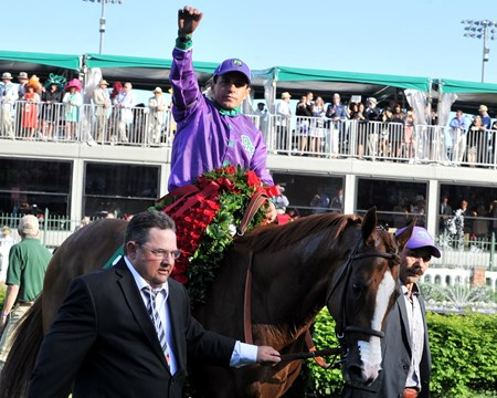 California Chrome is led to the winner's circle.