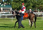 Kitten's Dumplings being lead to the winner's circle by Ken Ramsey.