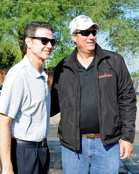 Caption:  Coach Rick Pitino, left, with Spendthrift Farm rep Mark Toothacre. Spendthrift Farm stands Into Mischief, sire of Goldencents, and owns Oaks filly Beholder