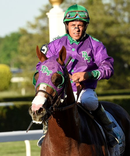 California Chrome, with jockey Victor Espinoza, returns to be unsaddled after finishing fourth in the 146th Belmont Stakes June 7, 2014 at Belmont Park.