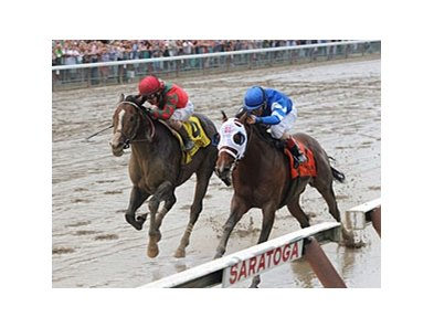Alpha (right) repels a challenge from Flat Out to win the Woodward.