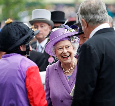 The Queen, with Sir Michael Stoute and Ryan Moore (left), after winning The Ascot Gold Cup.