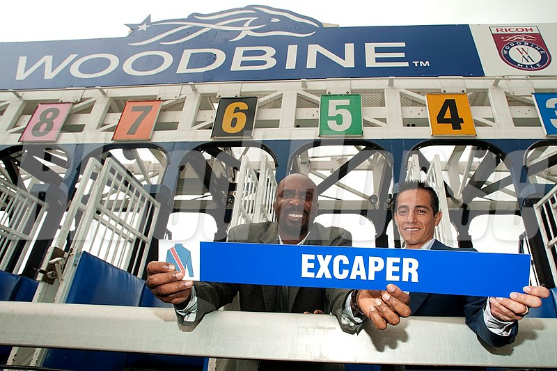 Jockey Luis Contreras and Devon White of the Toronto Blue Jays during the post position draw for the Woodbine Mile.