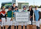 Julien Leparoux (center, green and blue silks) celebrates win 2000 with his fellow jockeys.