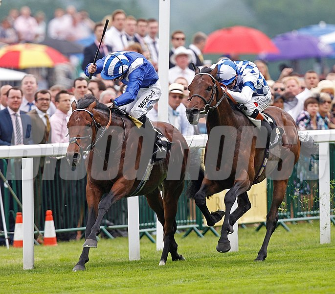 Al Kazeem and jockey James Doyle (right) win the Prince of Wales Stakes from Mukhadram (left) at Royal Ascot.