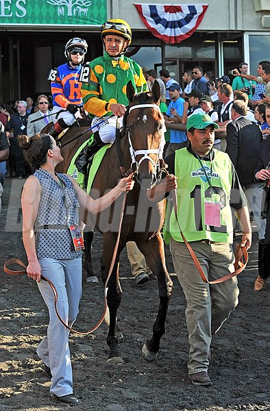 Palace Malice and jockey Mike Smith before winning the 2013 Belmont Stakes