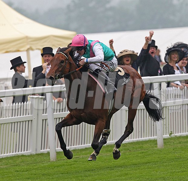 Riposte and jockey Tom Queally  running in the Ribblesdale Stakes June 20, 2013.