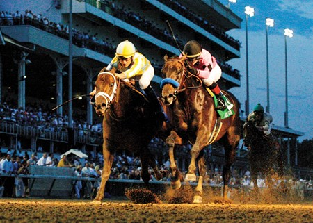 Code West (pink silks, inside) defeated Uncaptured (outside) by a head in the Matt Winn Stakes at Churchill Downs.