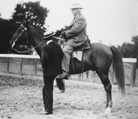 G.B. Morris watching over the track at Saratoga Race Course in 1903.