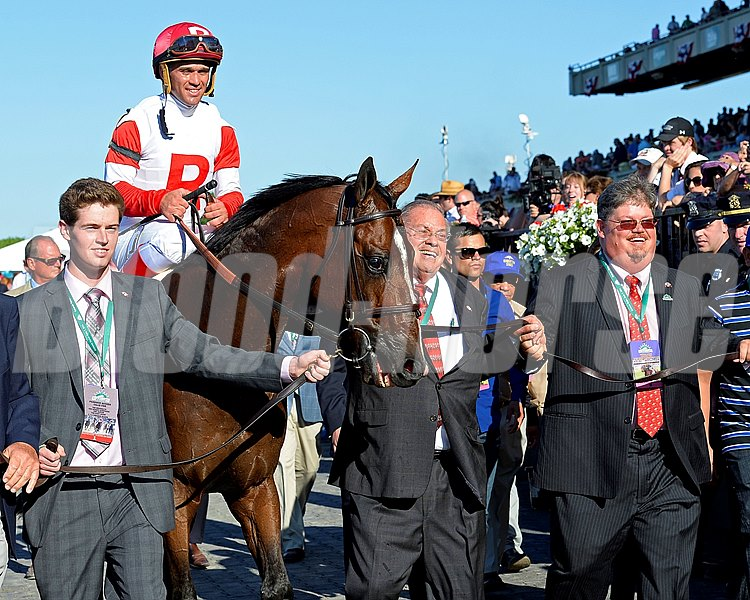 Jeff and Ken Ramsey, right of Real Solution, walking into the winner's Circle.